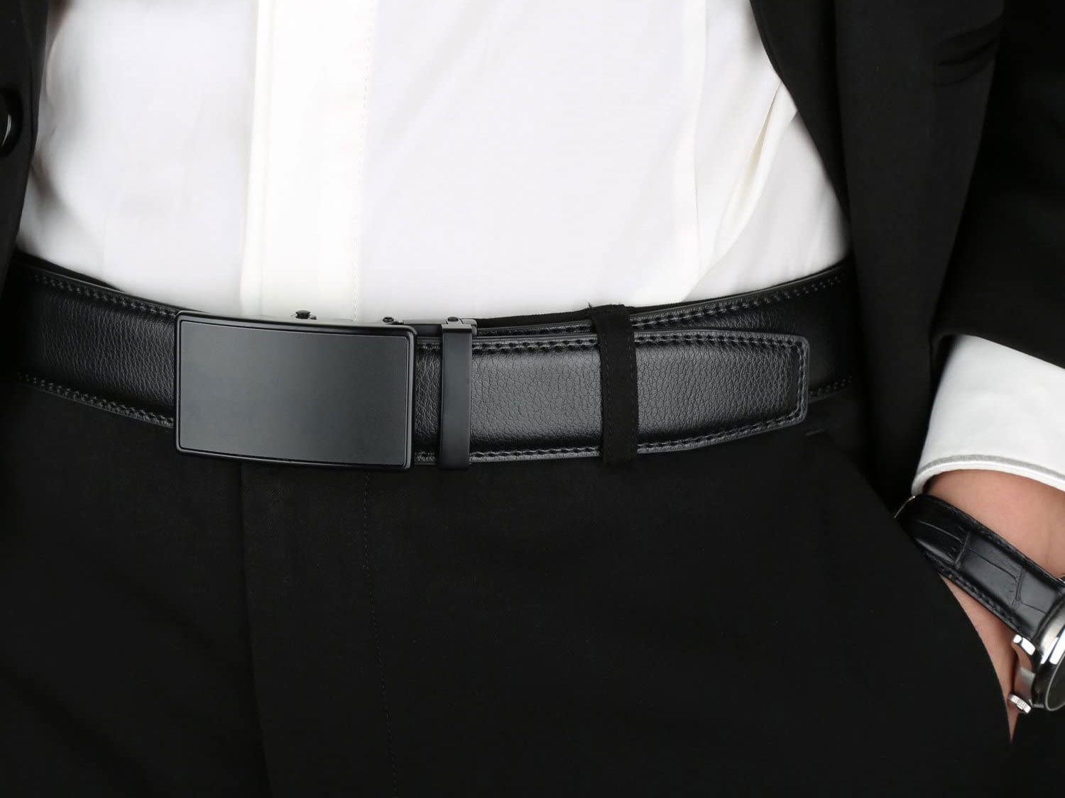 Close up of person in a black suit with a belt
