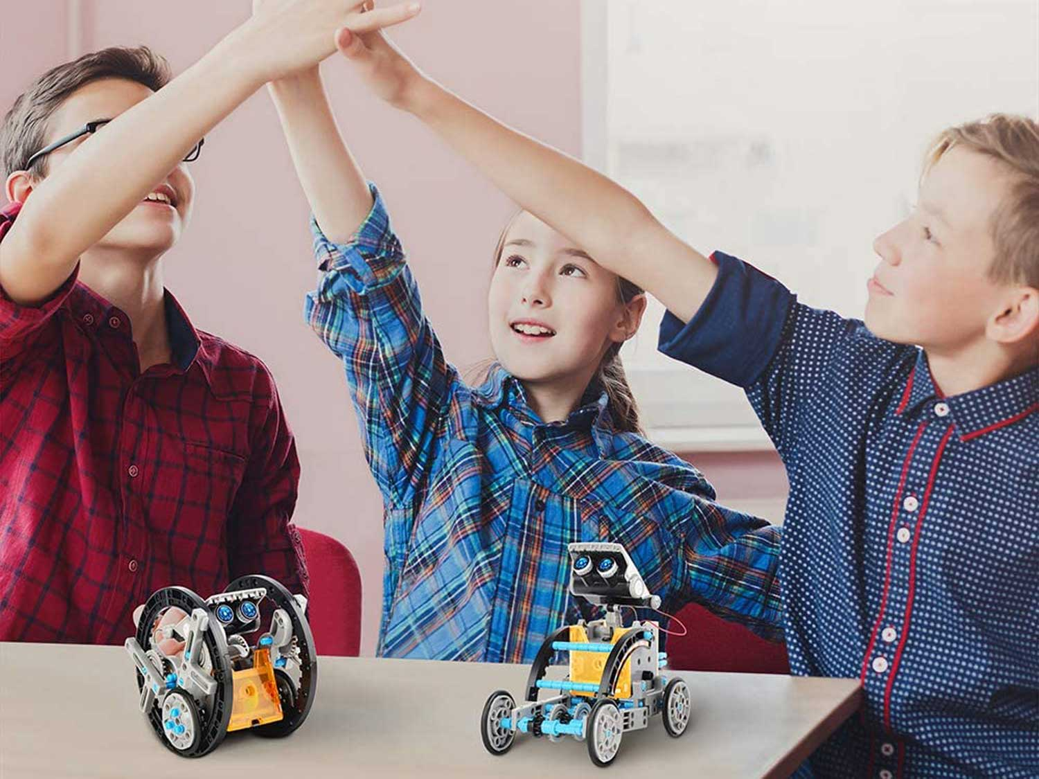 Kids playing with STEM robot toys