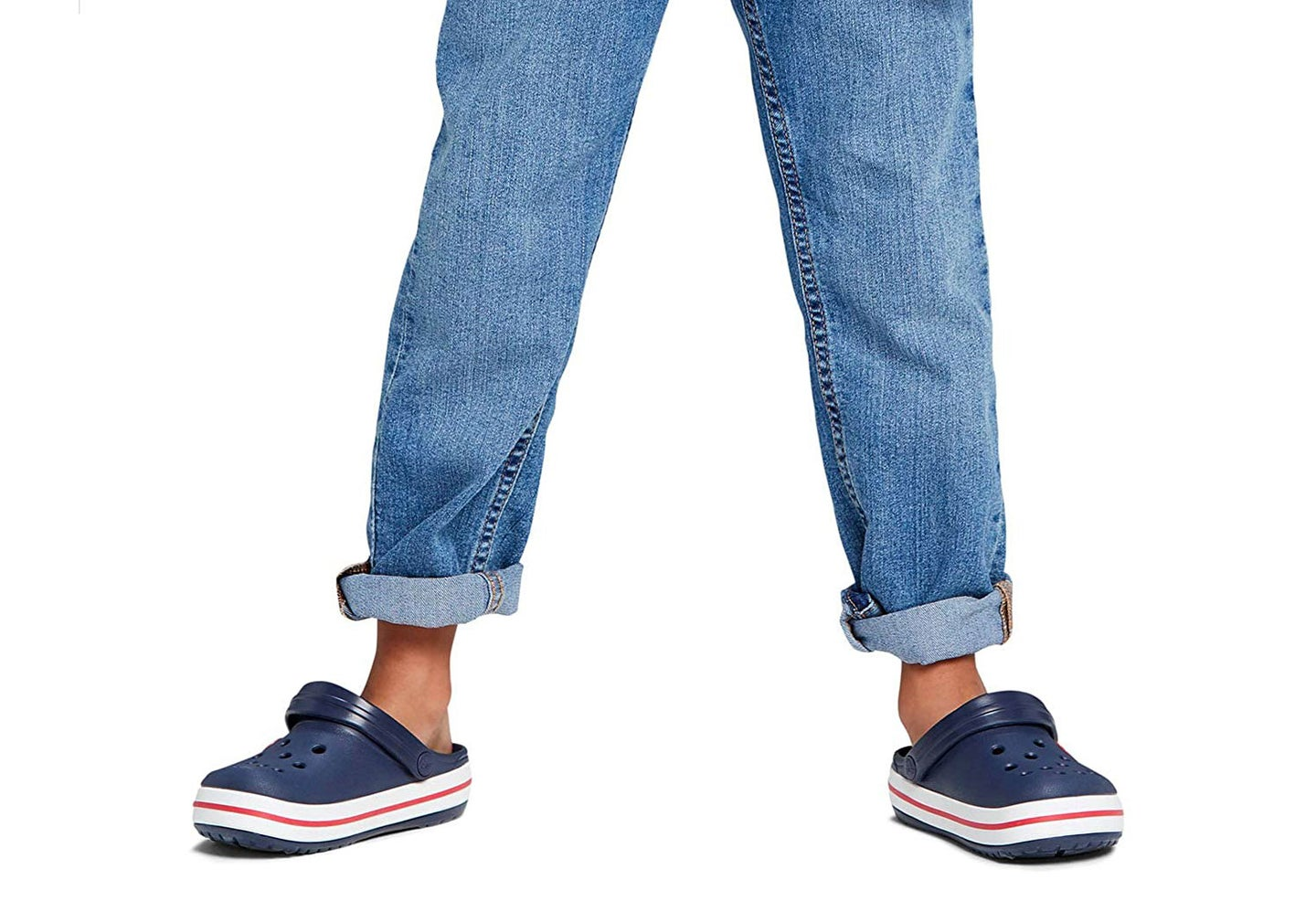 Child wearing jeans and Crocs water shoes