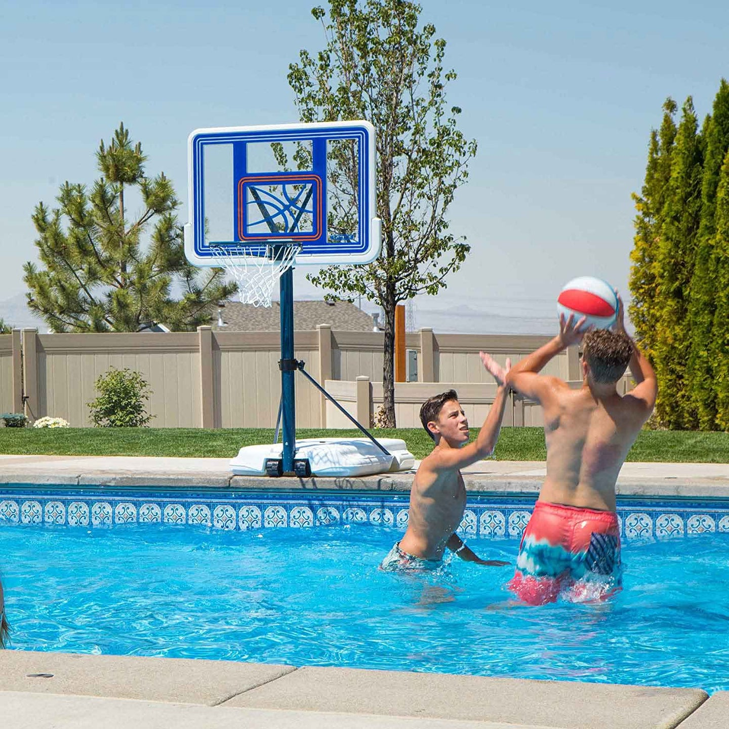People playing basketball in a pool