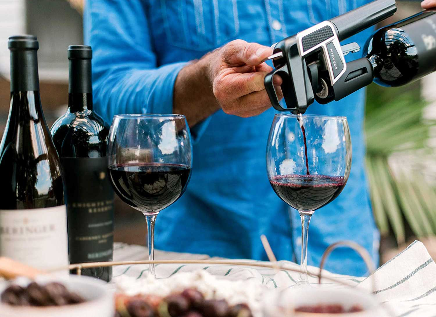 Person pouring red wine