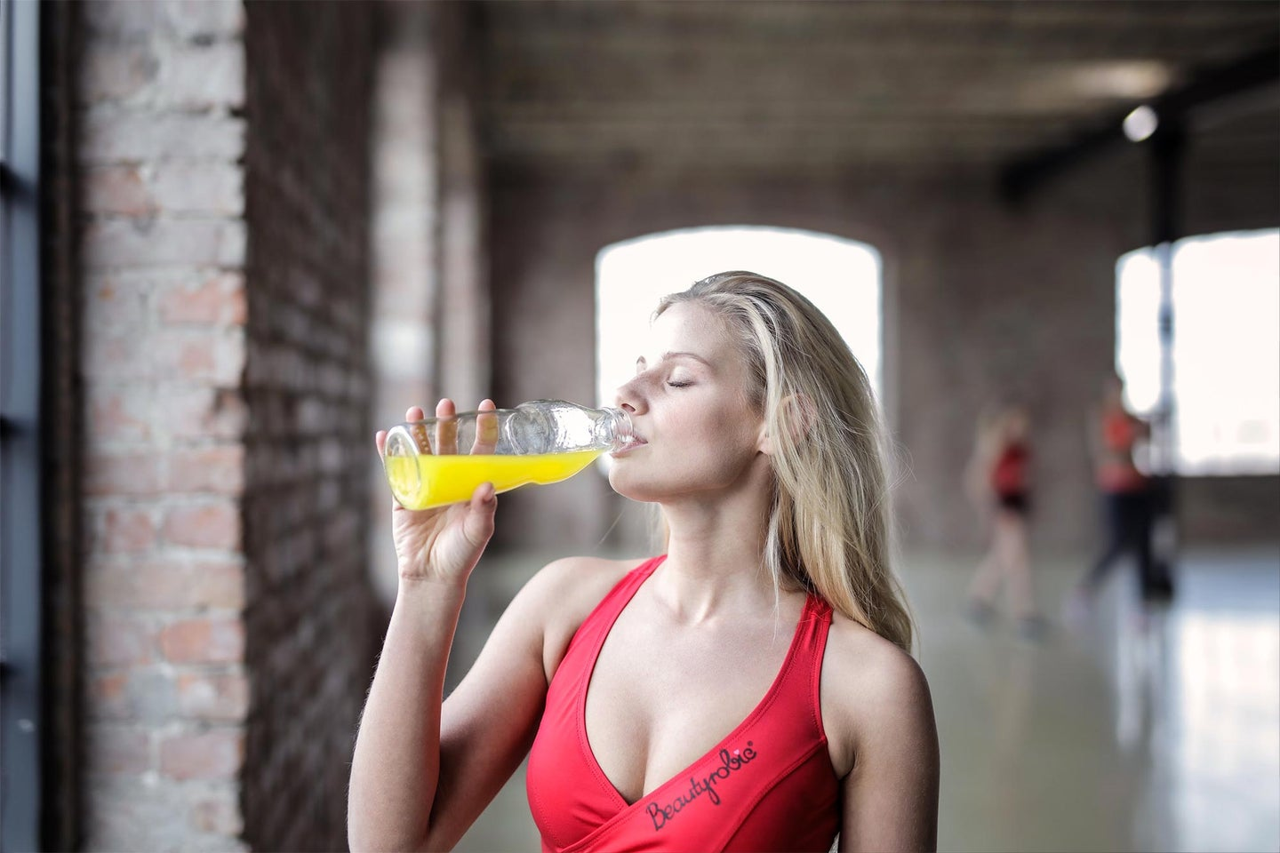 Woman at the gym rehydrating