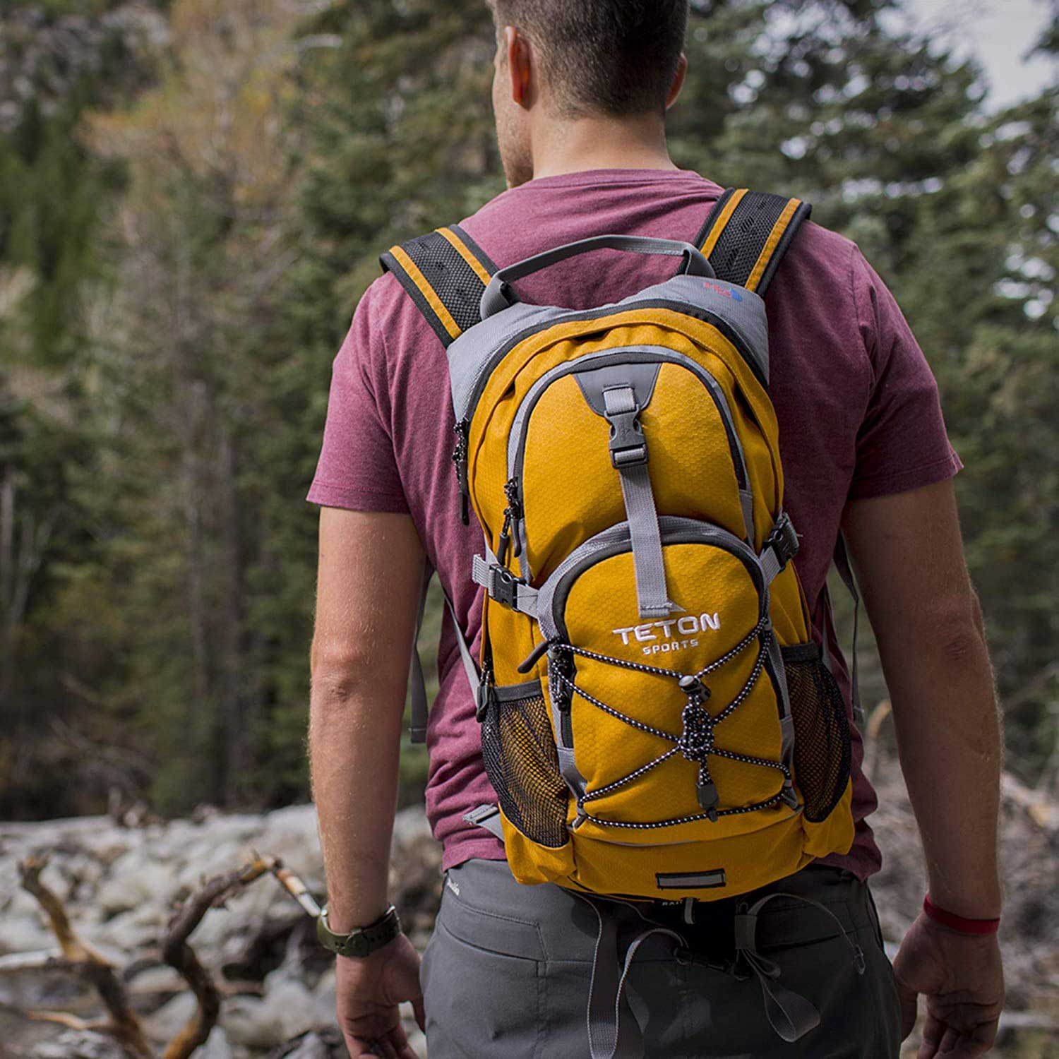 Guy wearing yellow backpack on a hike
