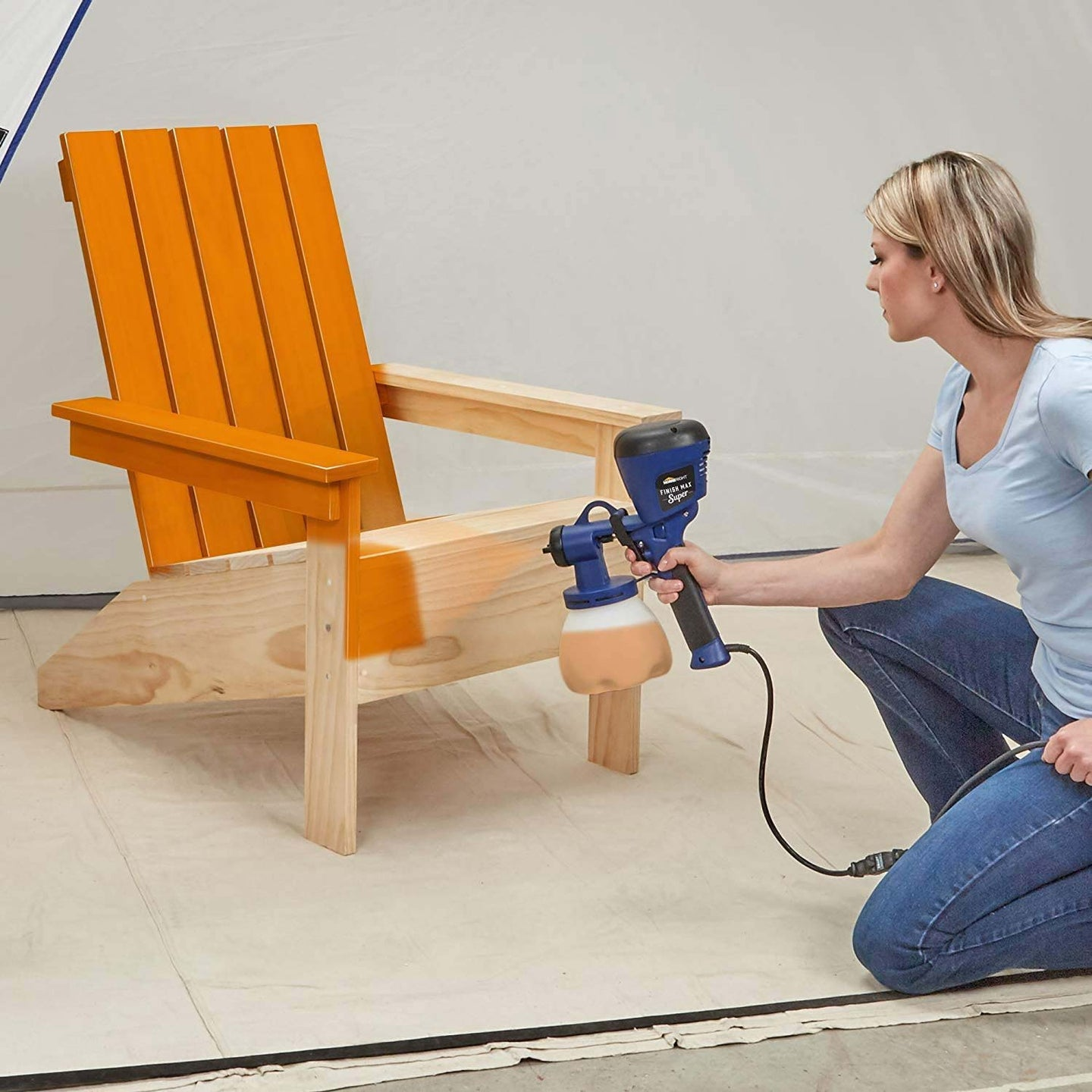 Woman spray painting a chair