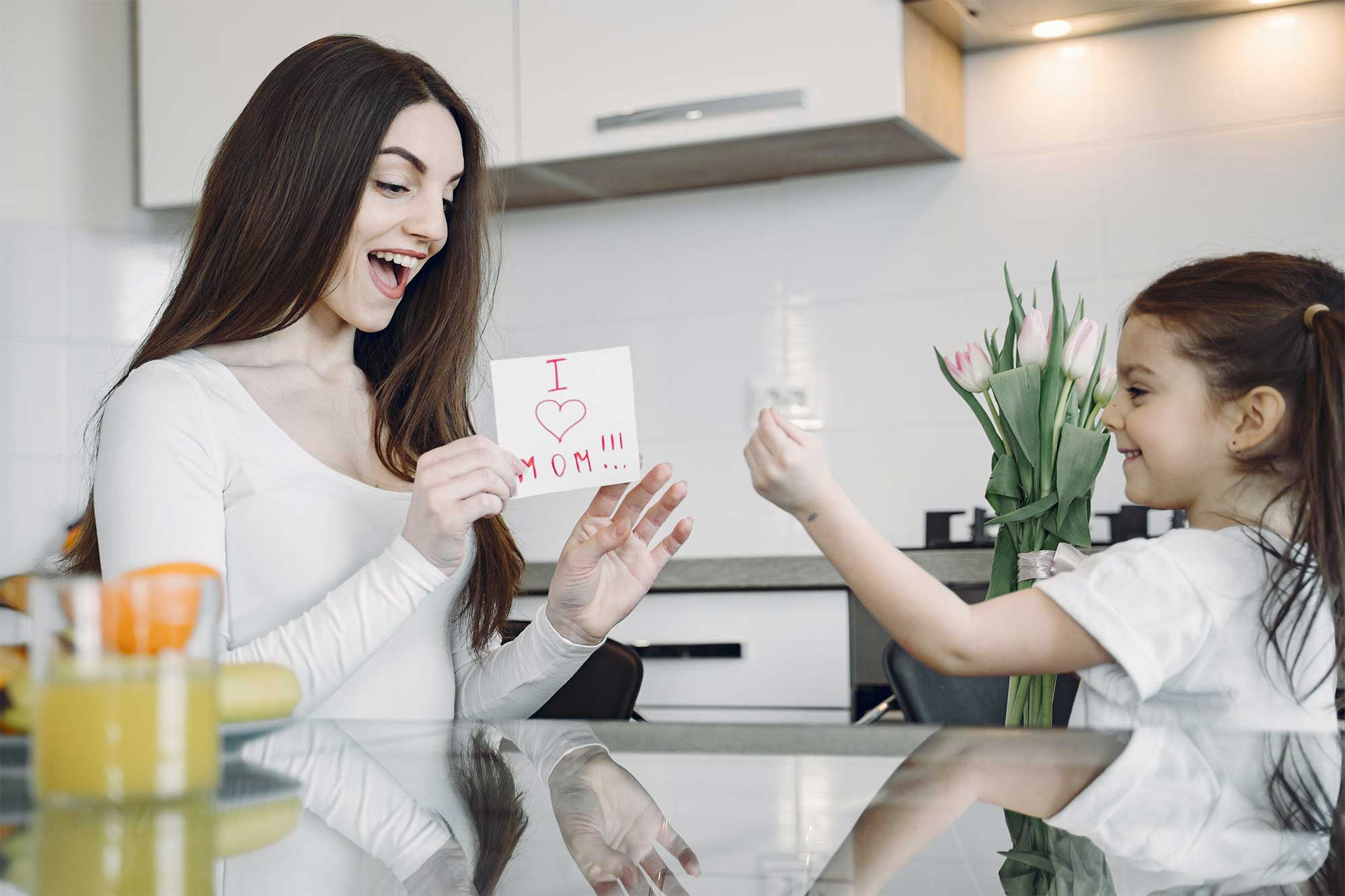 Mother and daughter in a kitchen.
