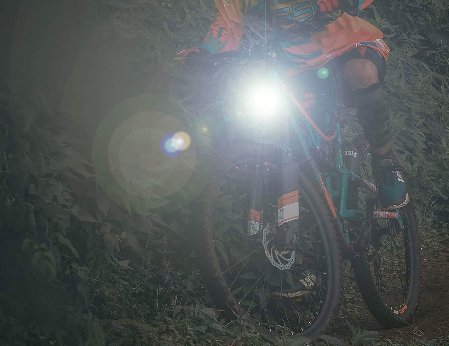 Person riding a bike at night