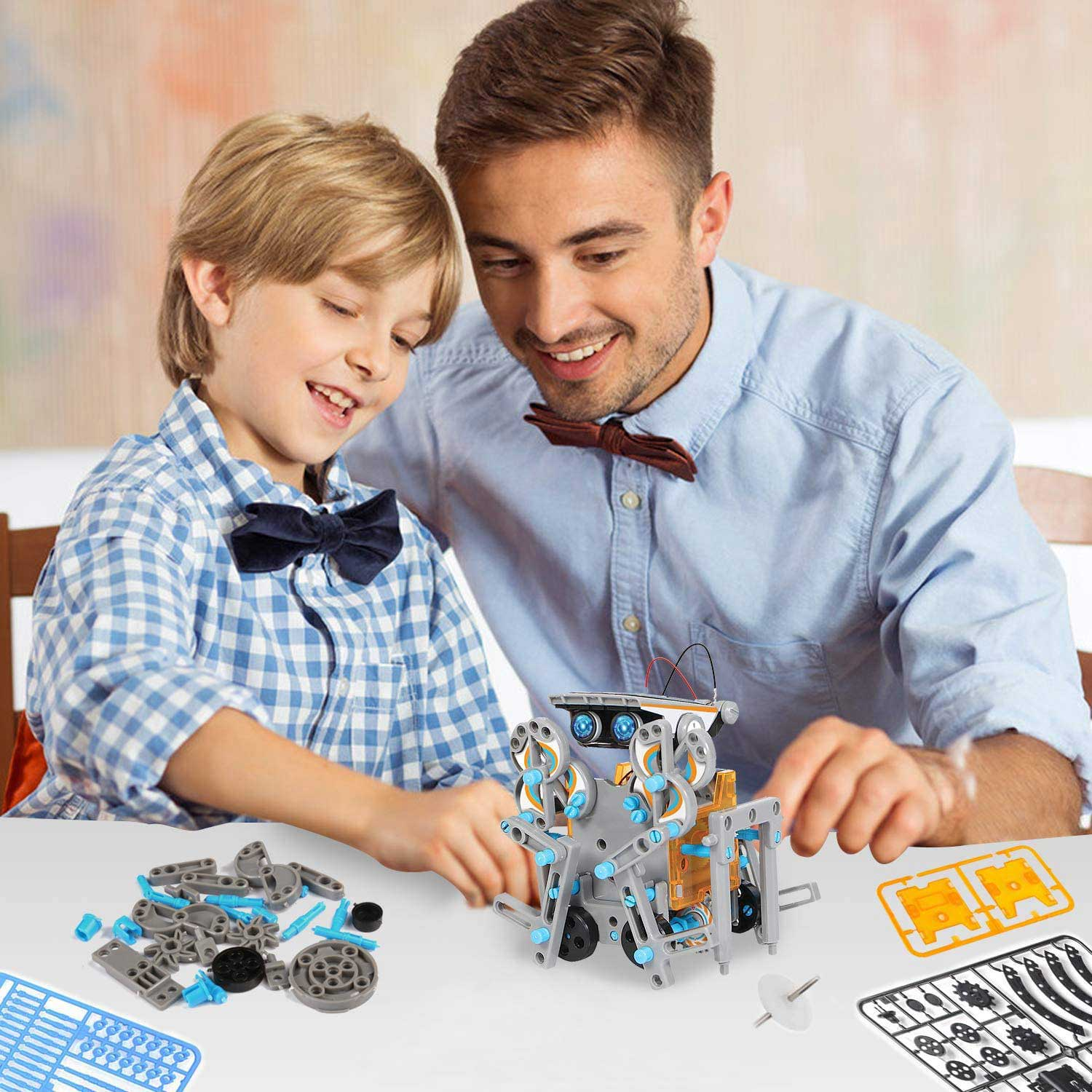 Man and boy playing with robot toys