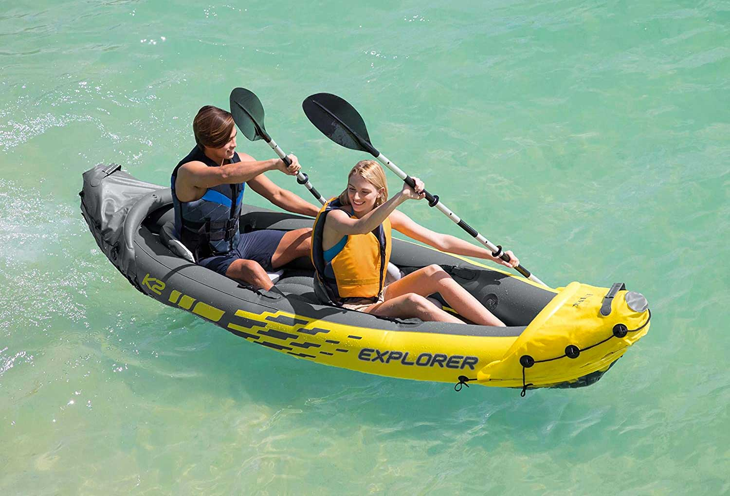 Two people in an inflatable kayak