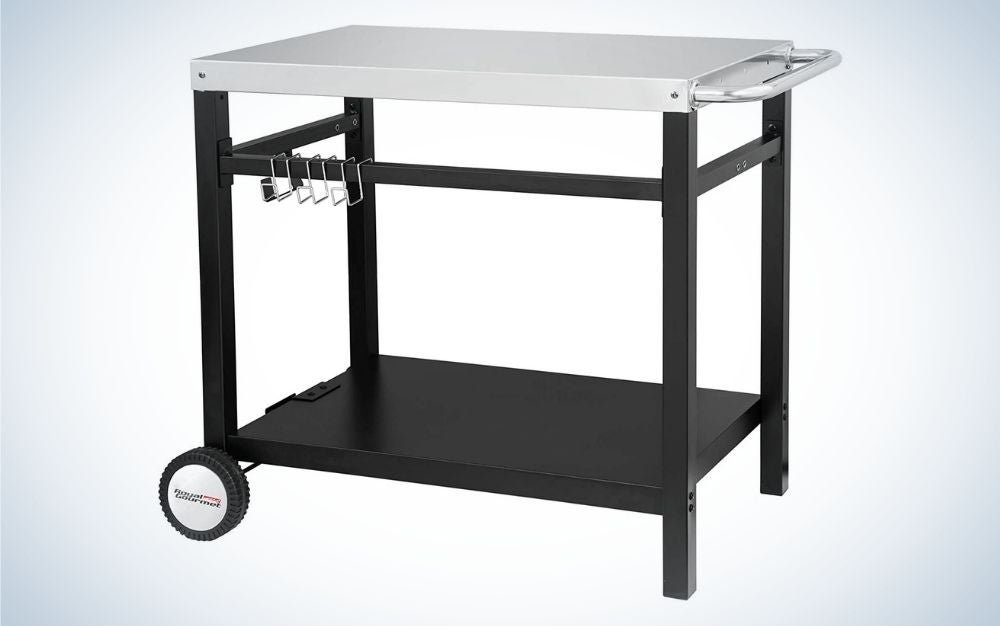 The Royal Gourmet Double-Shelf Movable Dining Cart Table is the best overall among outdoor kitchen accessories.