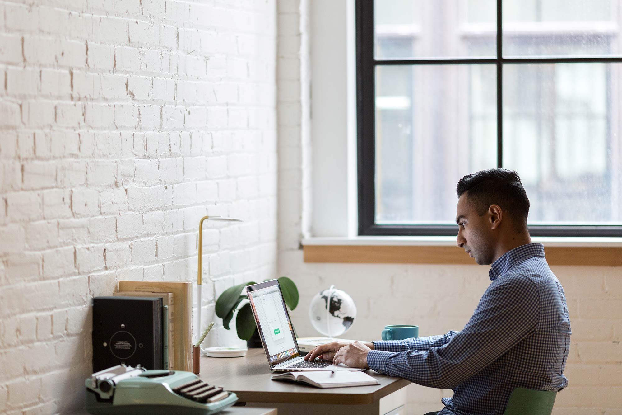 Man working at a desk and laptop