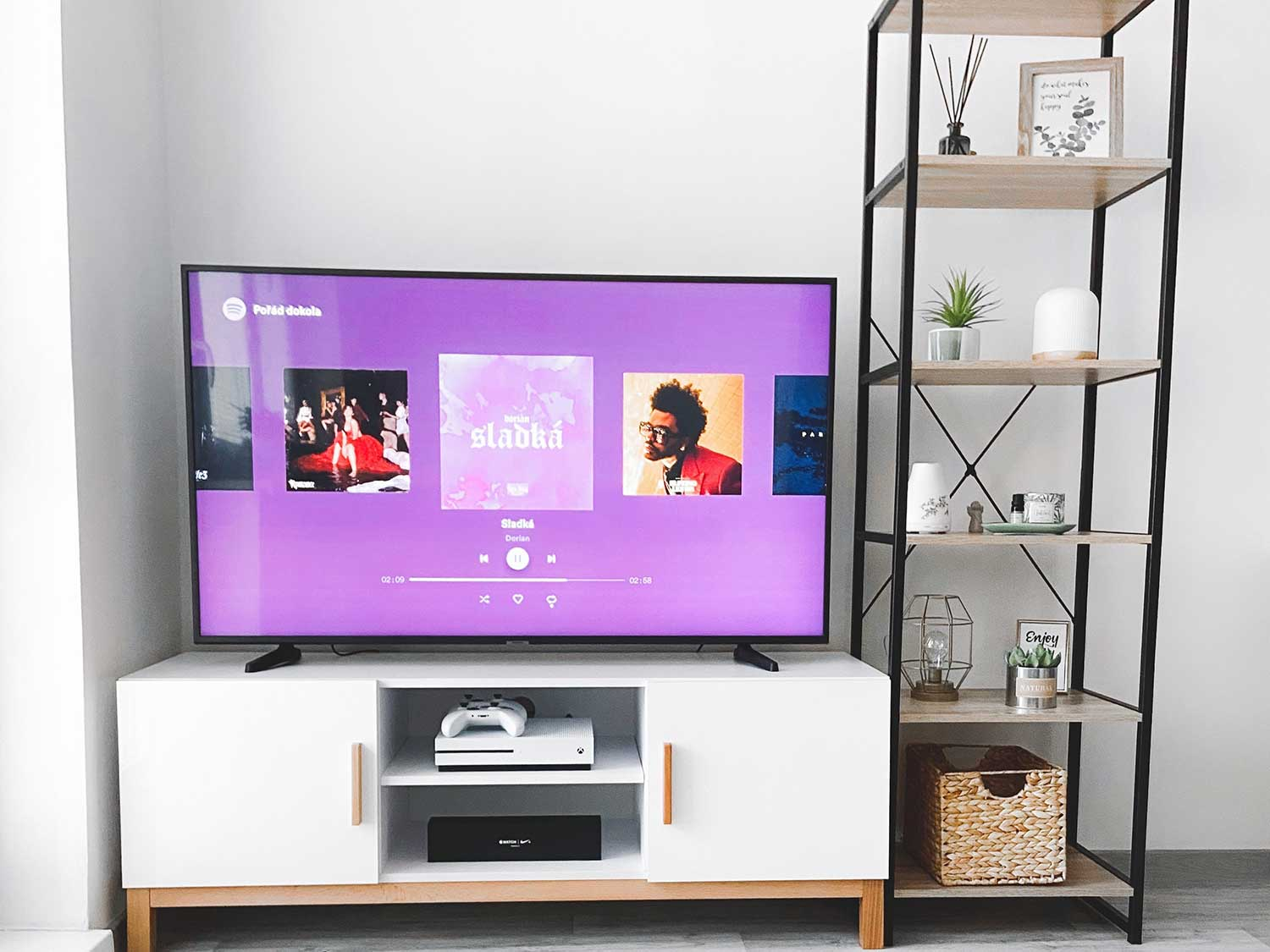 living room entertainment center with tv