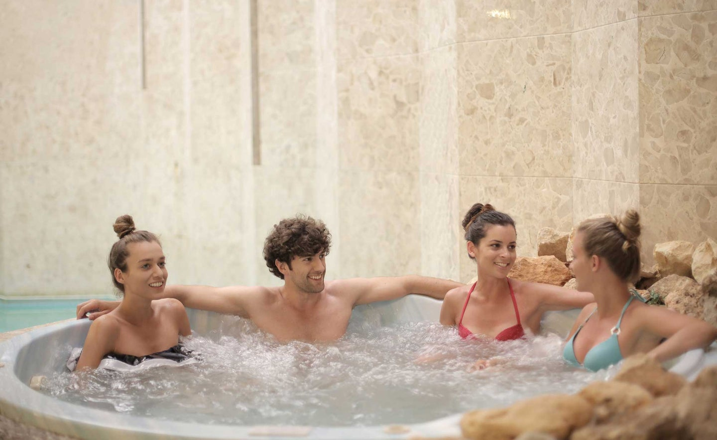 People in an inflatable hot tub