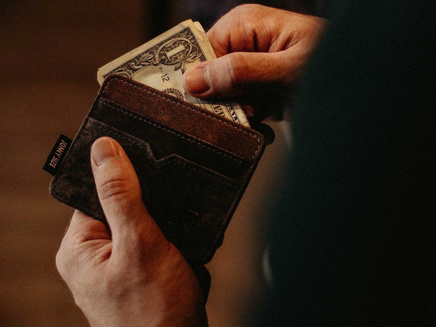 Man removing money from wallet