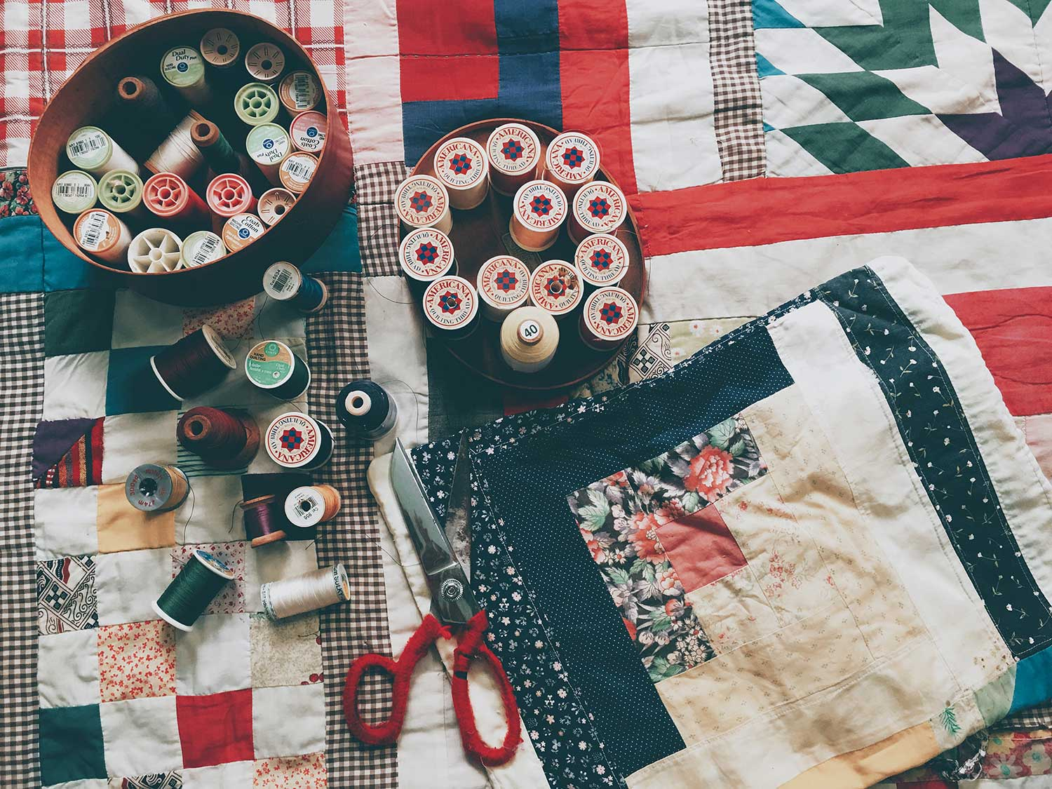 Quilting tools spread on quilt