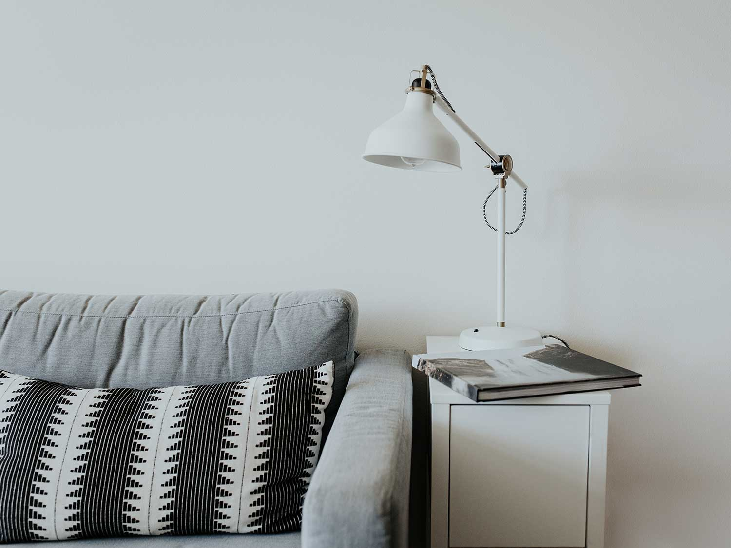 Living room side table with lamp and couch