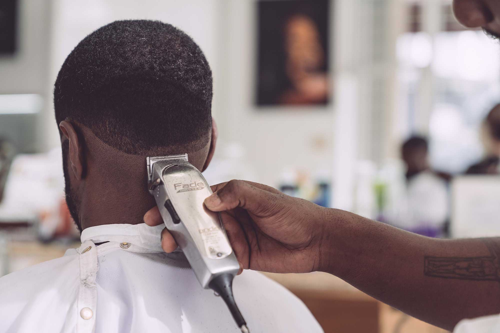 Guy getting a haircut with clippers