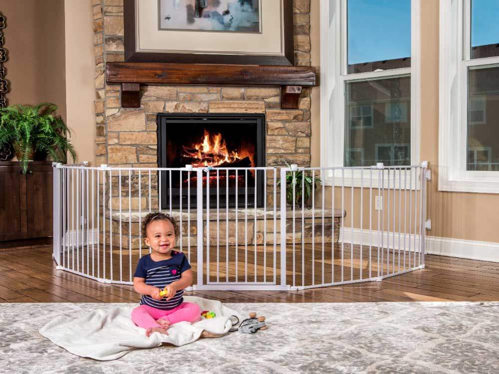 Baby sits in front of baby gate.