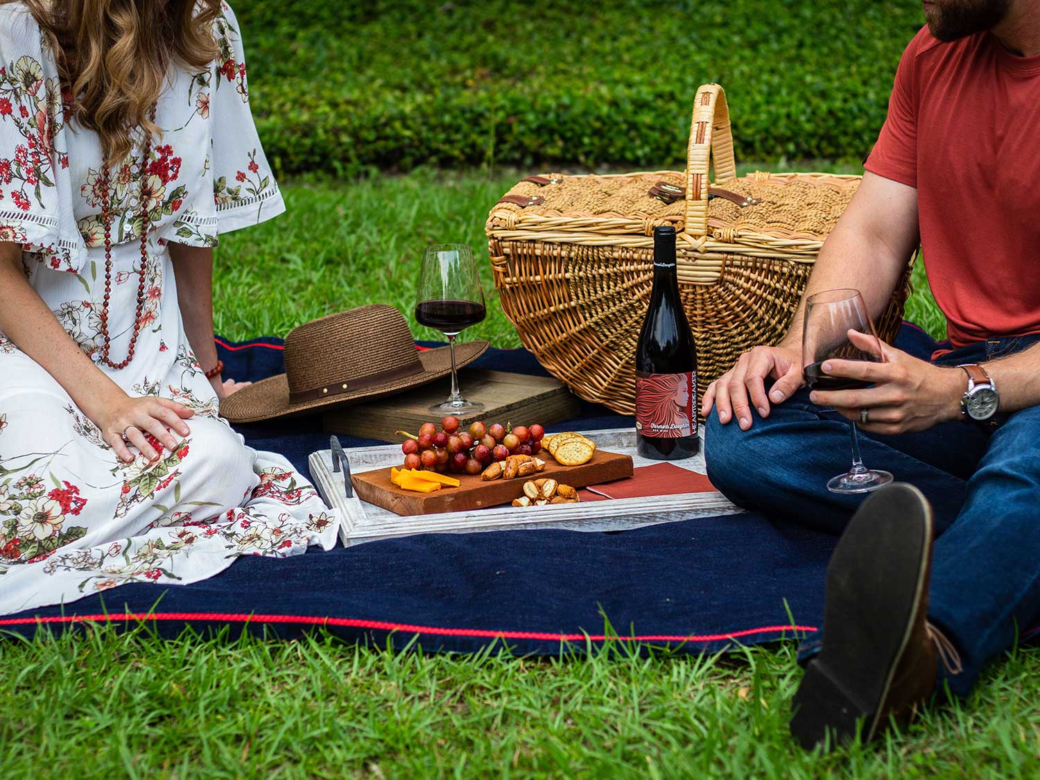 Man and woman having picnic in grass.
