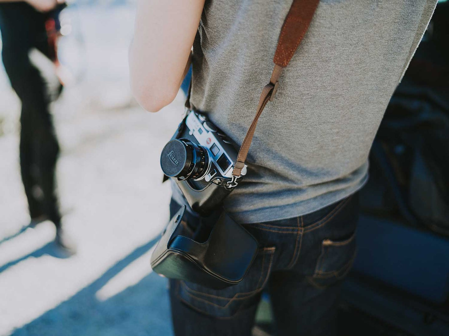 Man wearing jeans with camera.