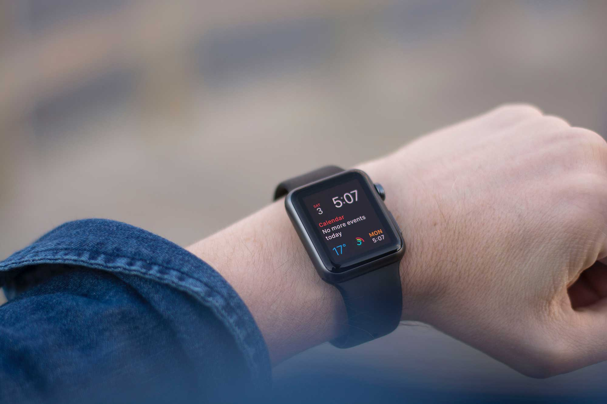 Person's arm wearing a smart watch