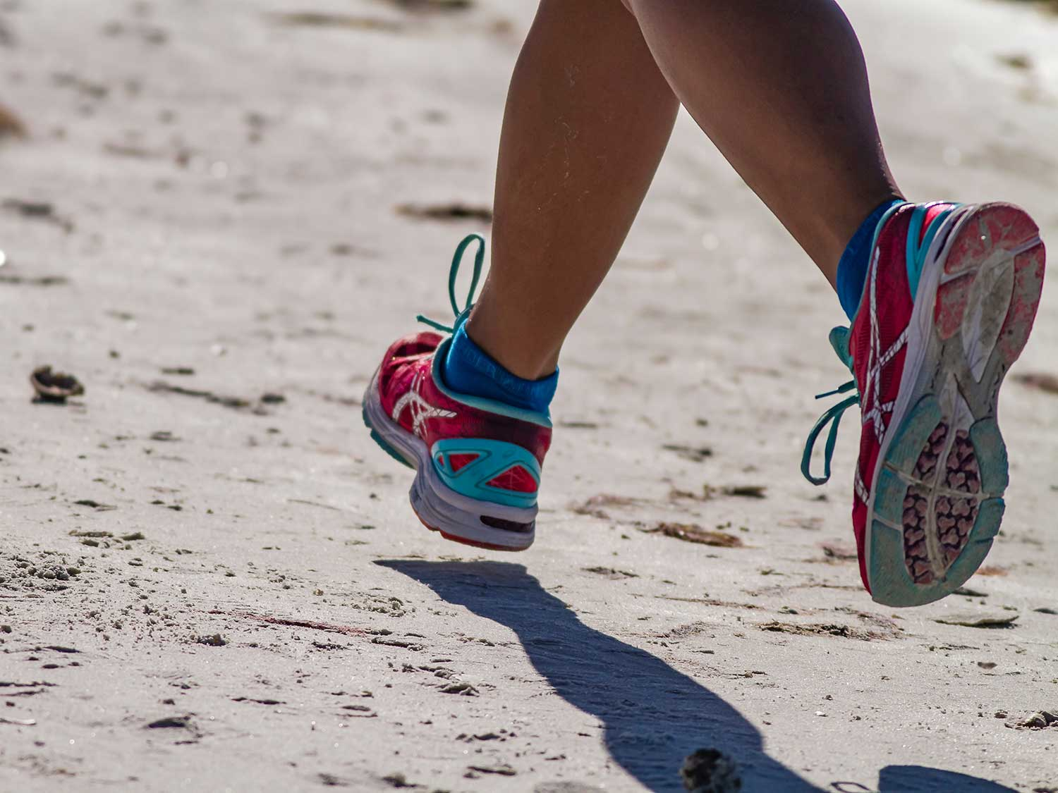 Running on beach with running shoes.