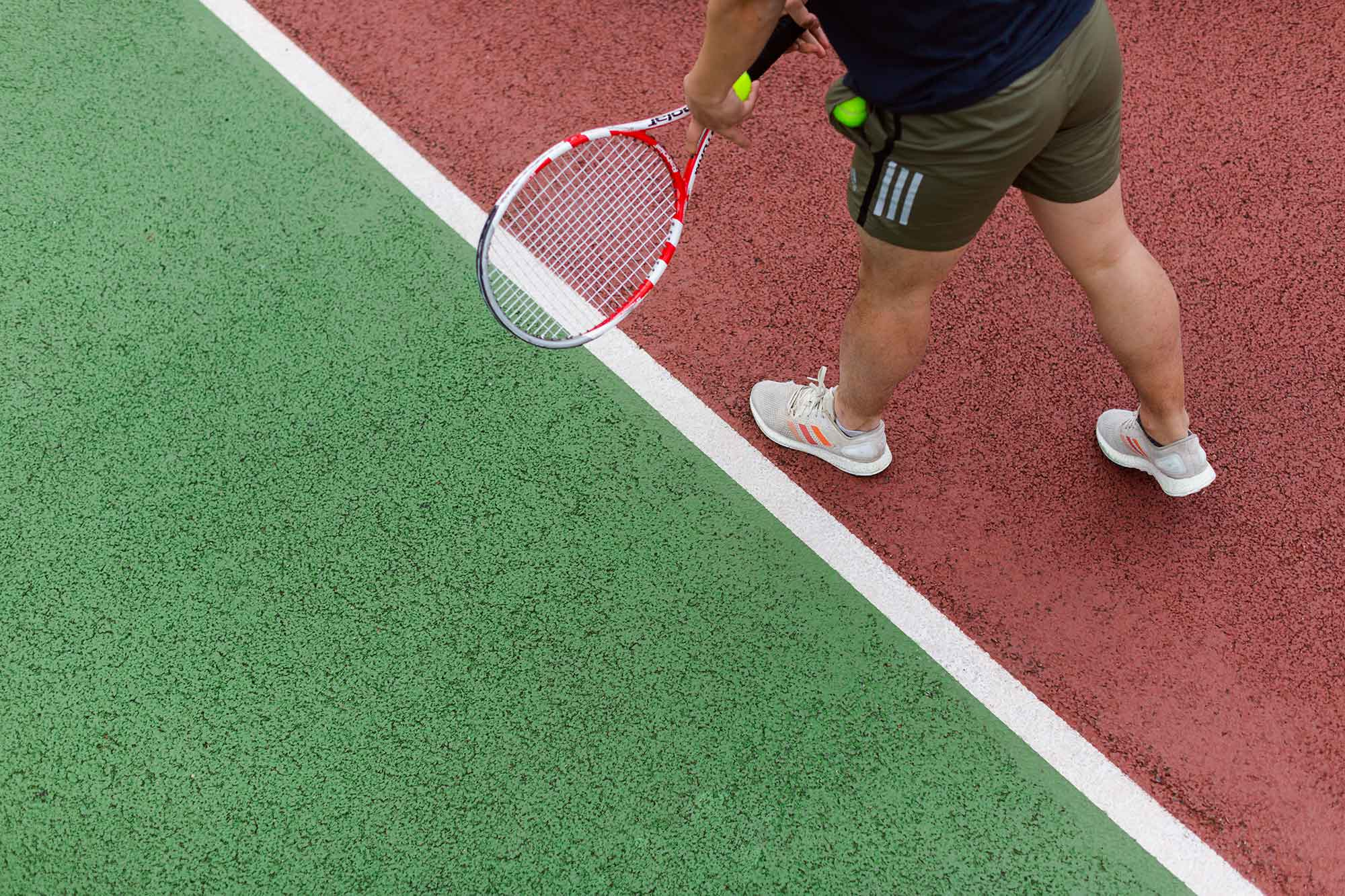 Person playing tennis on the court
