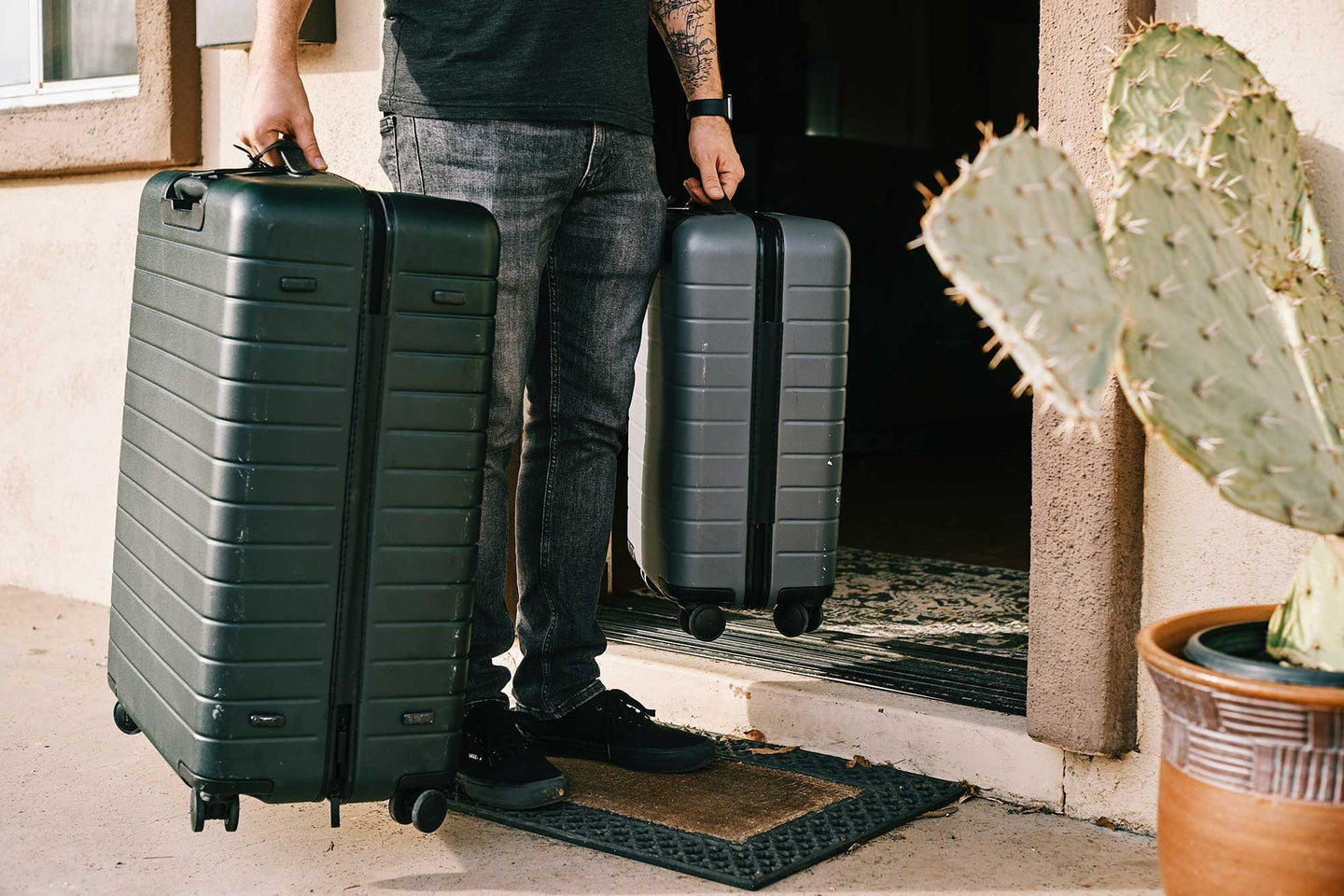 Guy holding suitcases