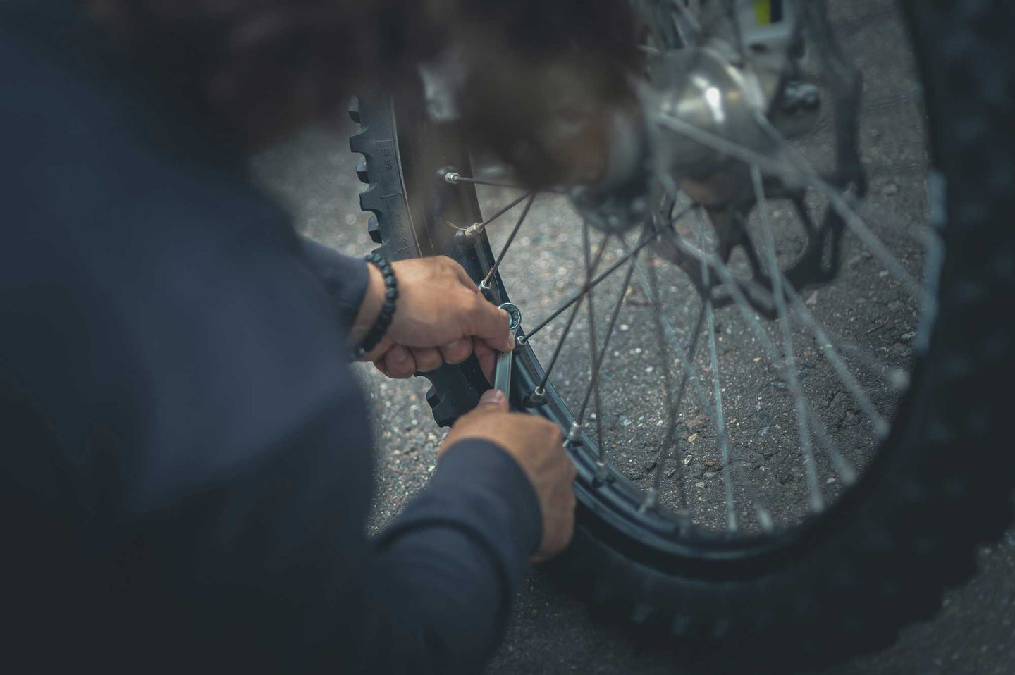 Person fixing a bike tire