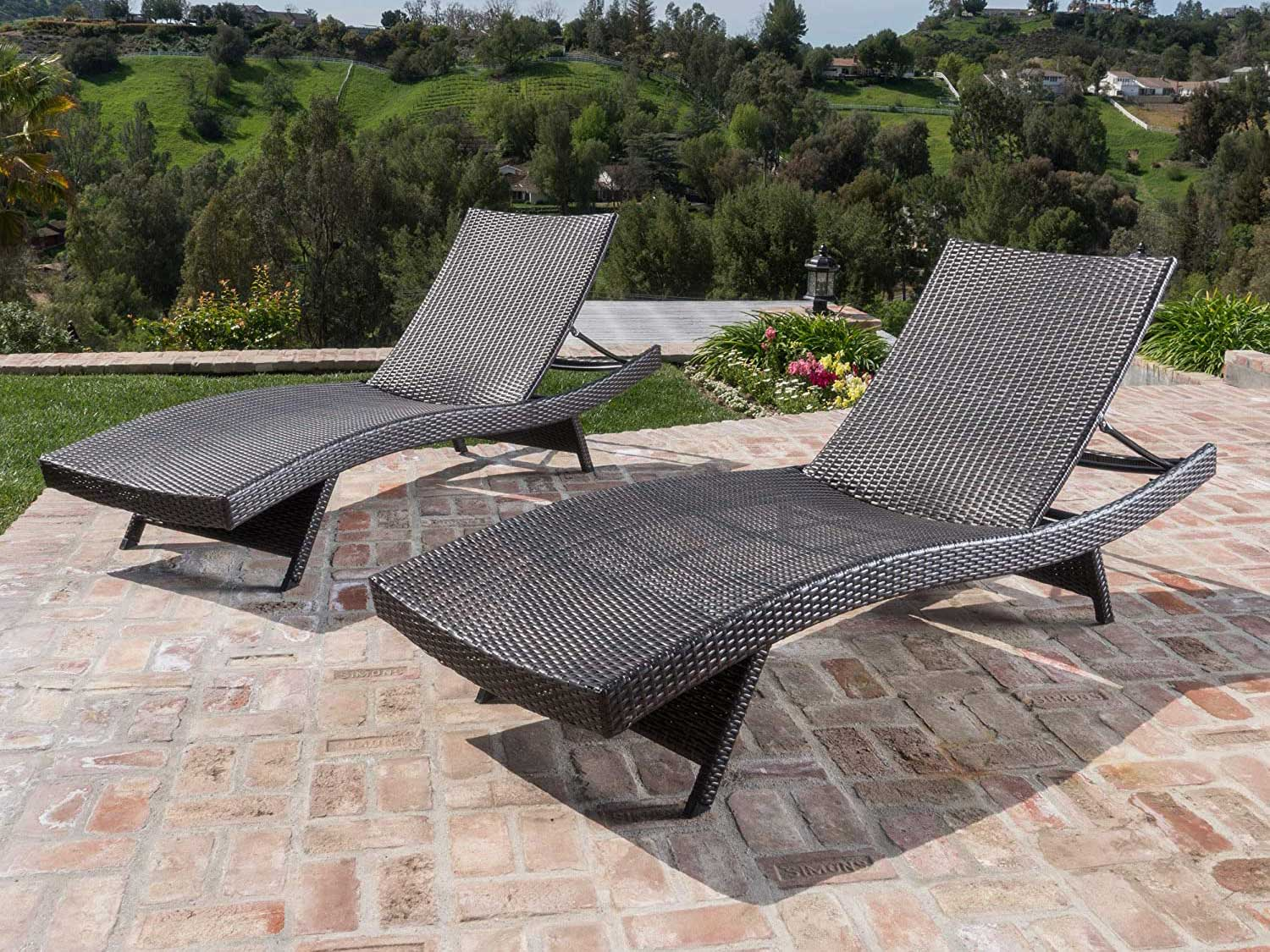 Chaise lounge on patio.