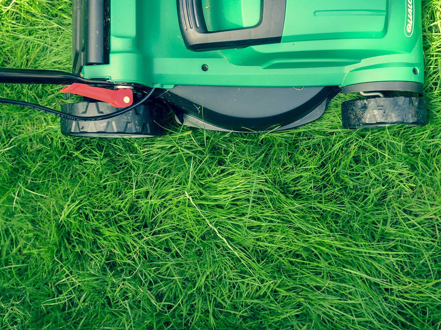Electric lawnmowers mowing grass.