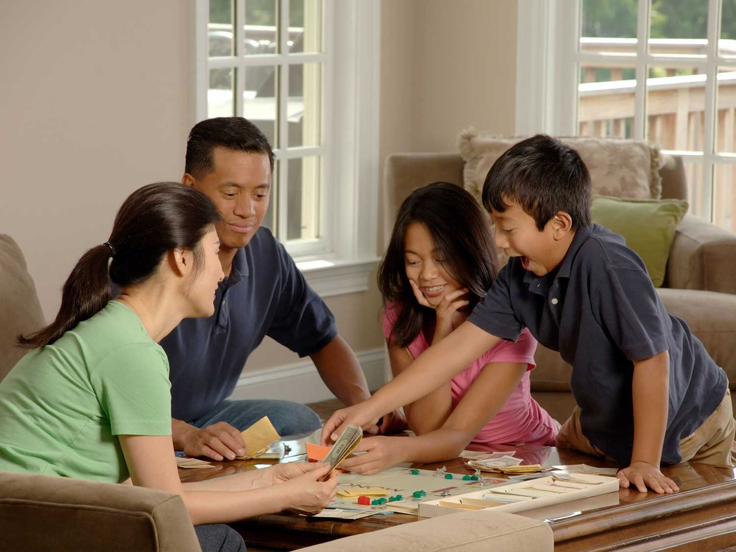 Family playing Monopoly.