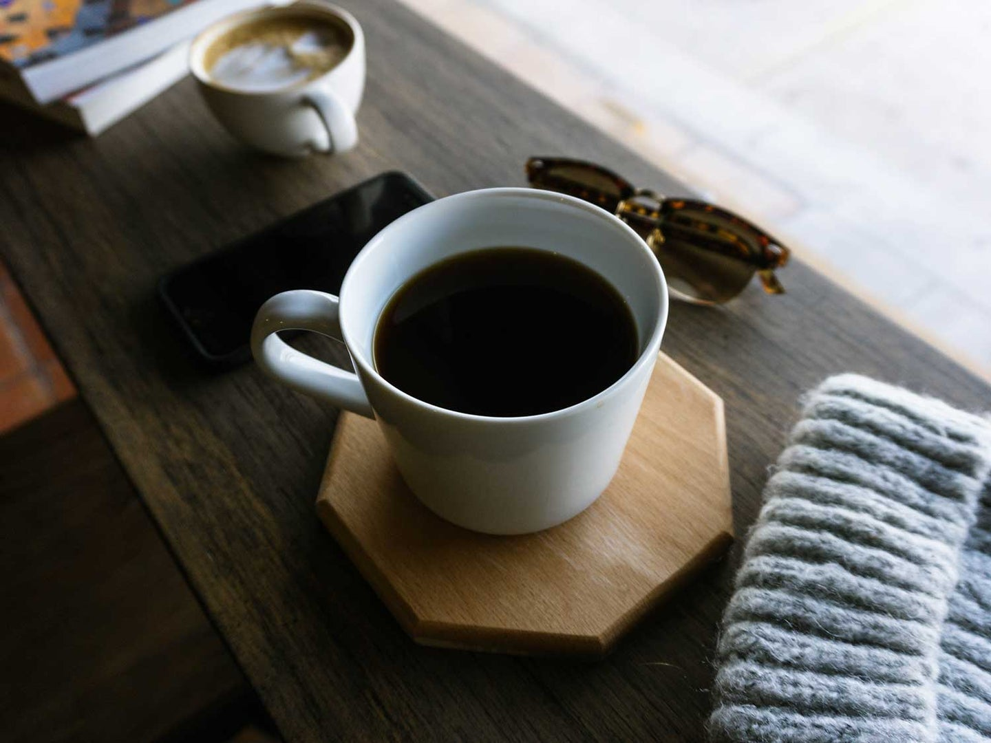 Coffee cup on coaster.