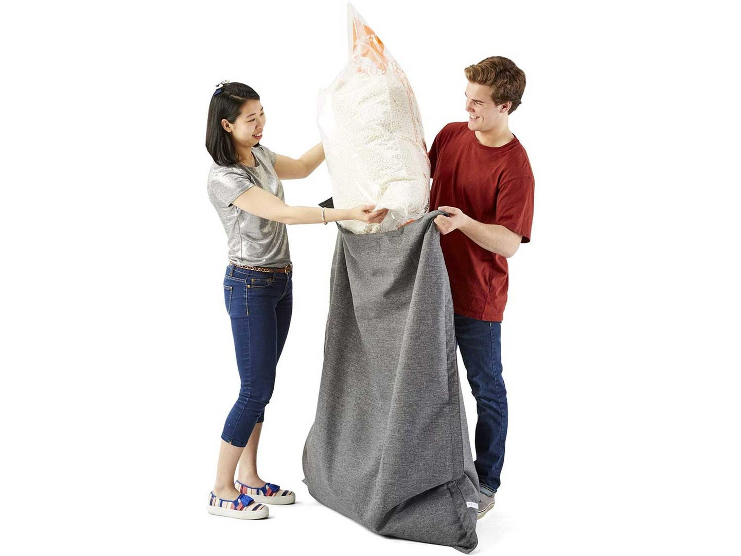 Man and woman fill beanbag with beanbag refill.