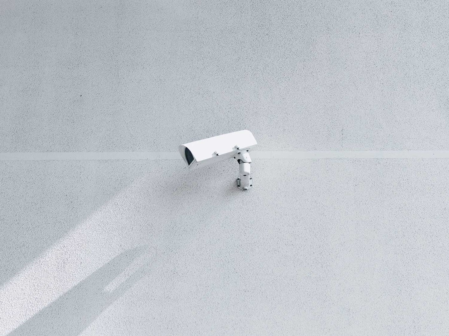 Security camera on wall.