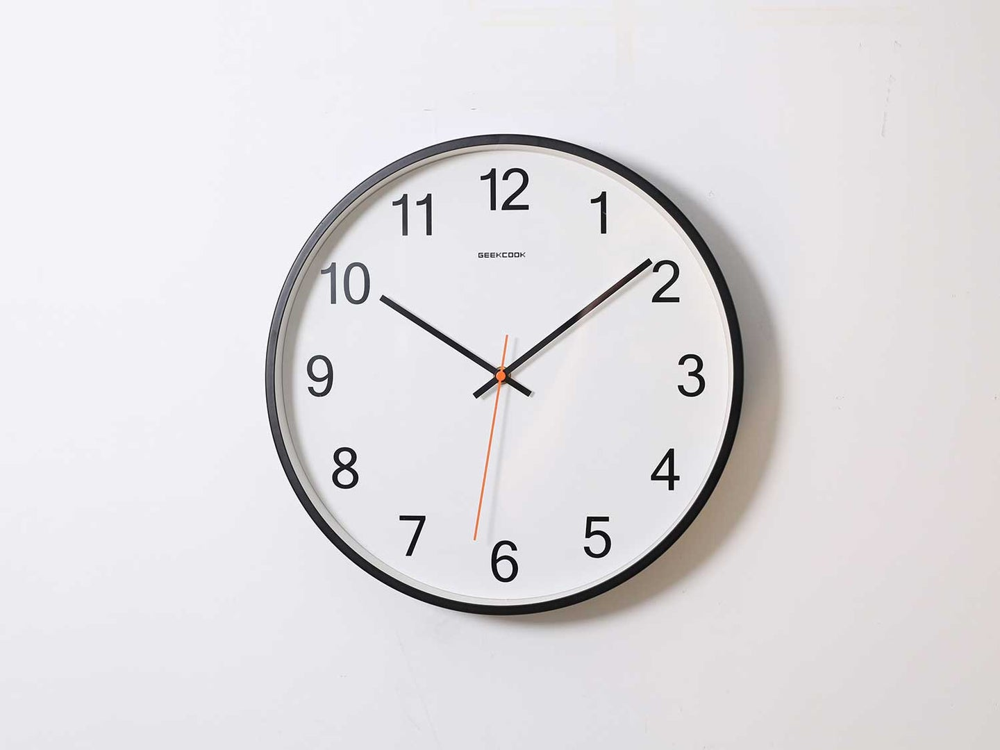 Wall clock on white wall.
