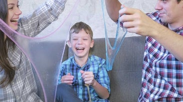 Family having fun playing with slime made with slime kit.