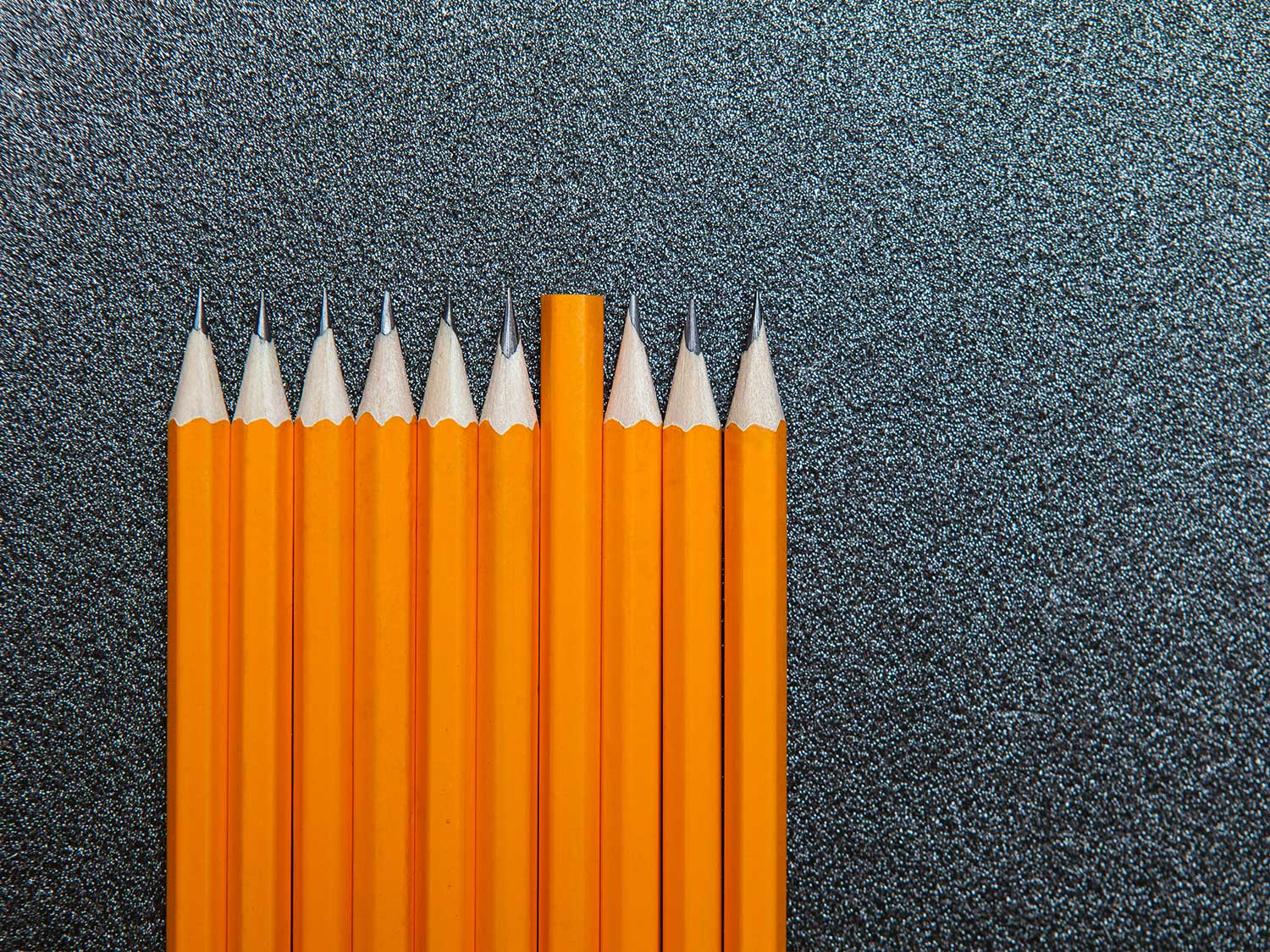 Sharpened pencils on carpet.