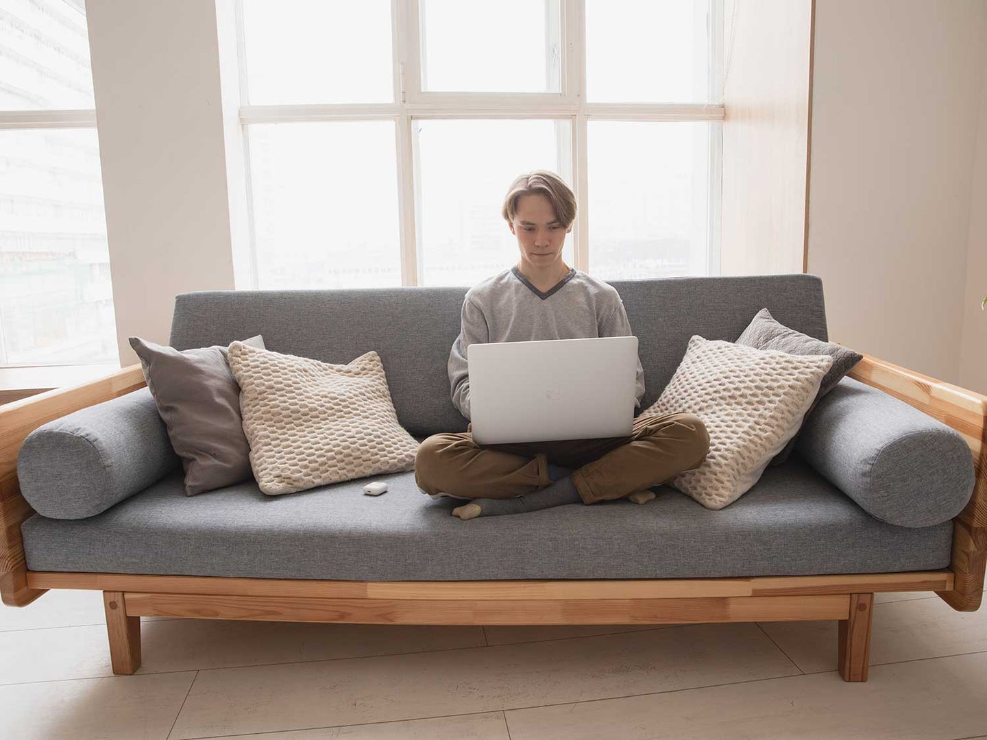 Man sitting on couch with computer.