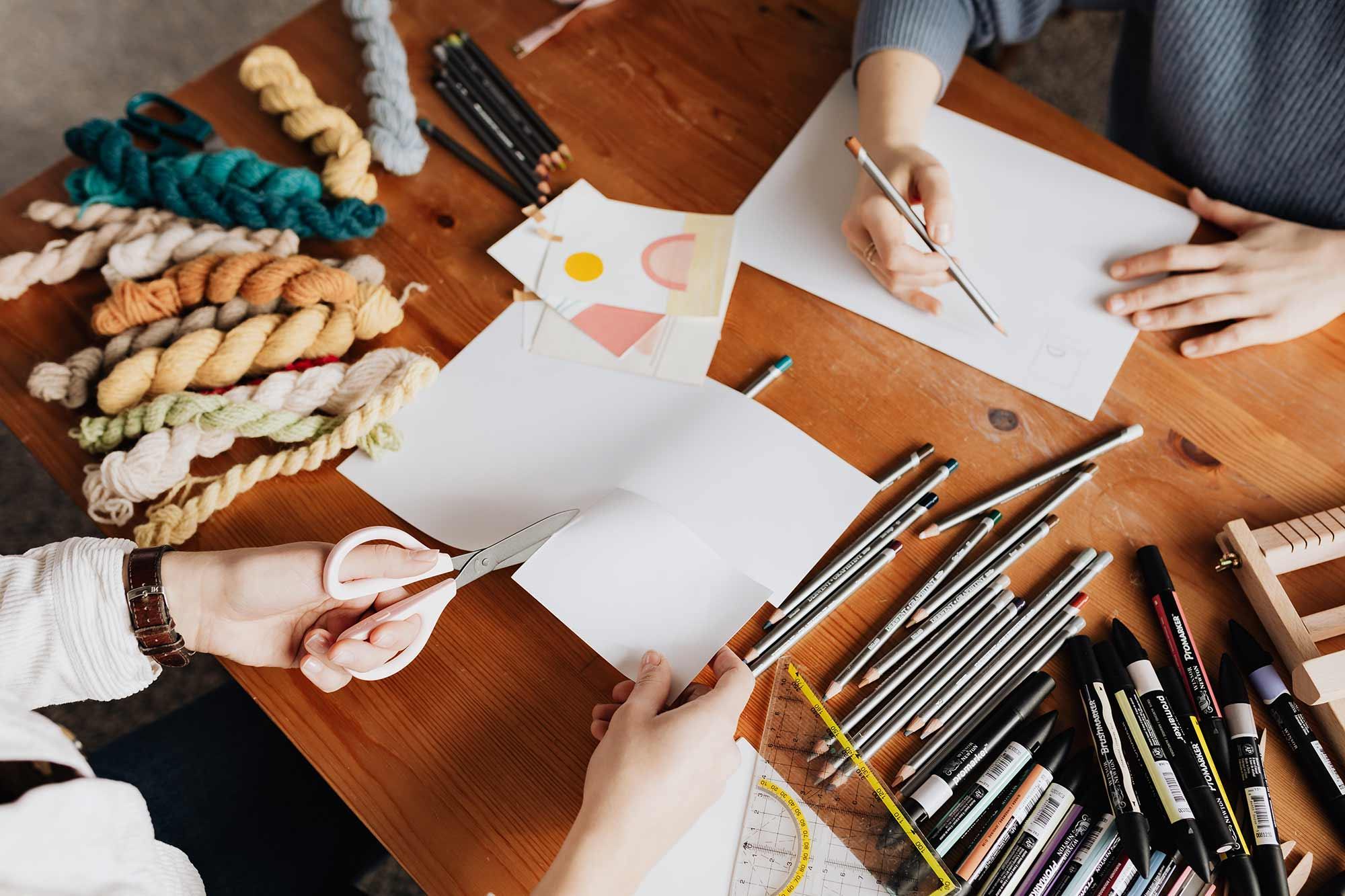 People doing arts and crafts on a table