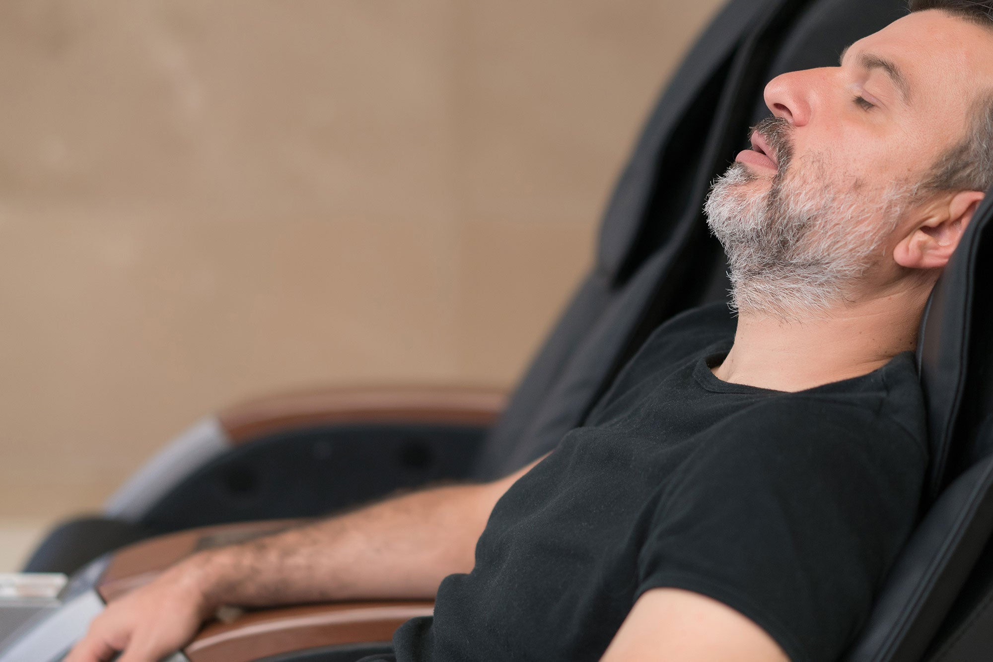 Guy relaxing in a massage chair