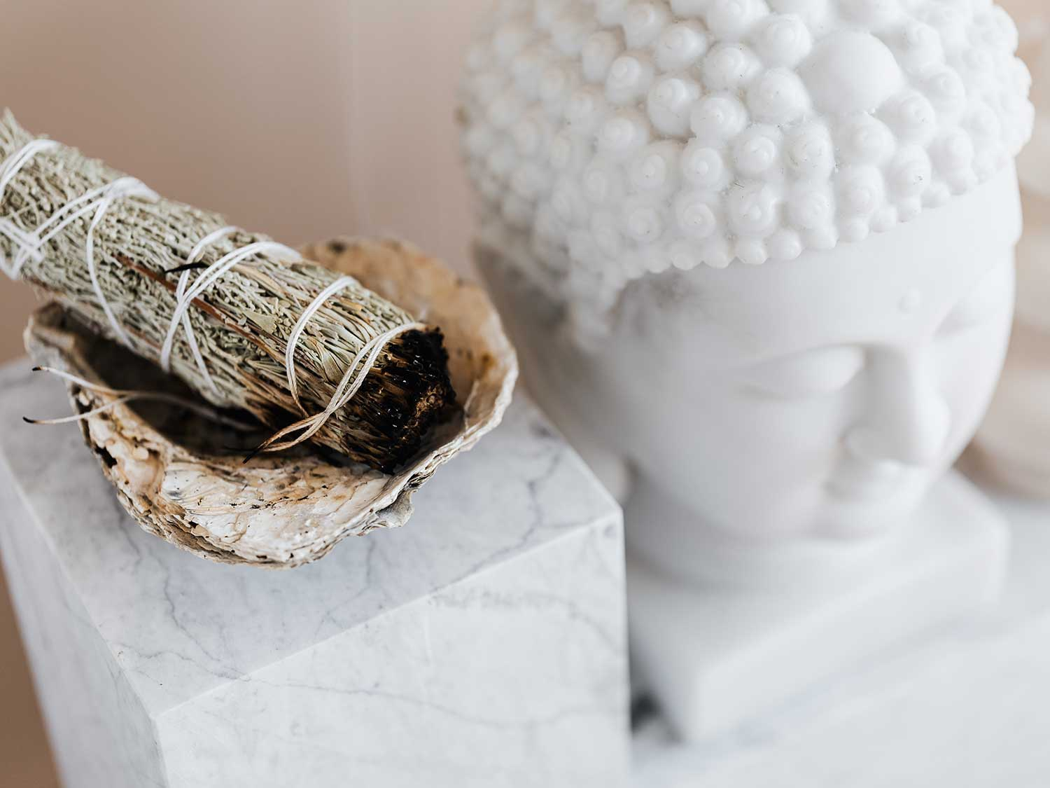 Burning sage to cleanse space.