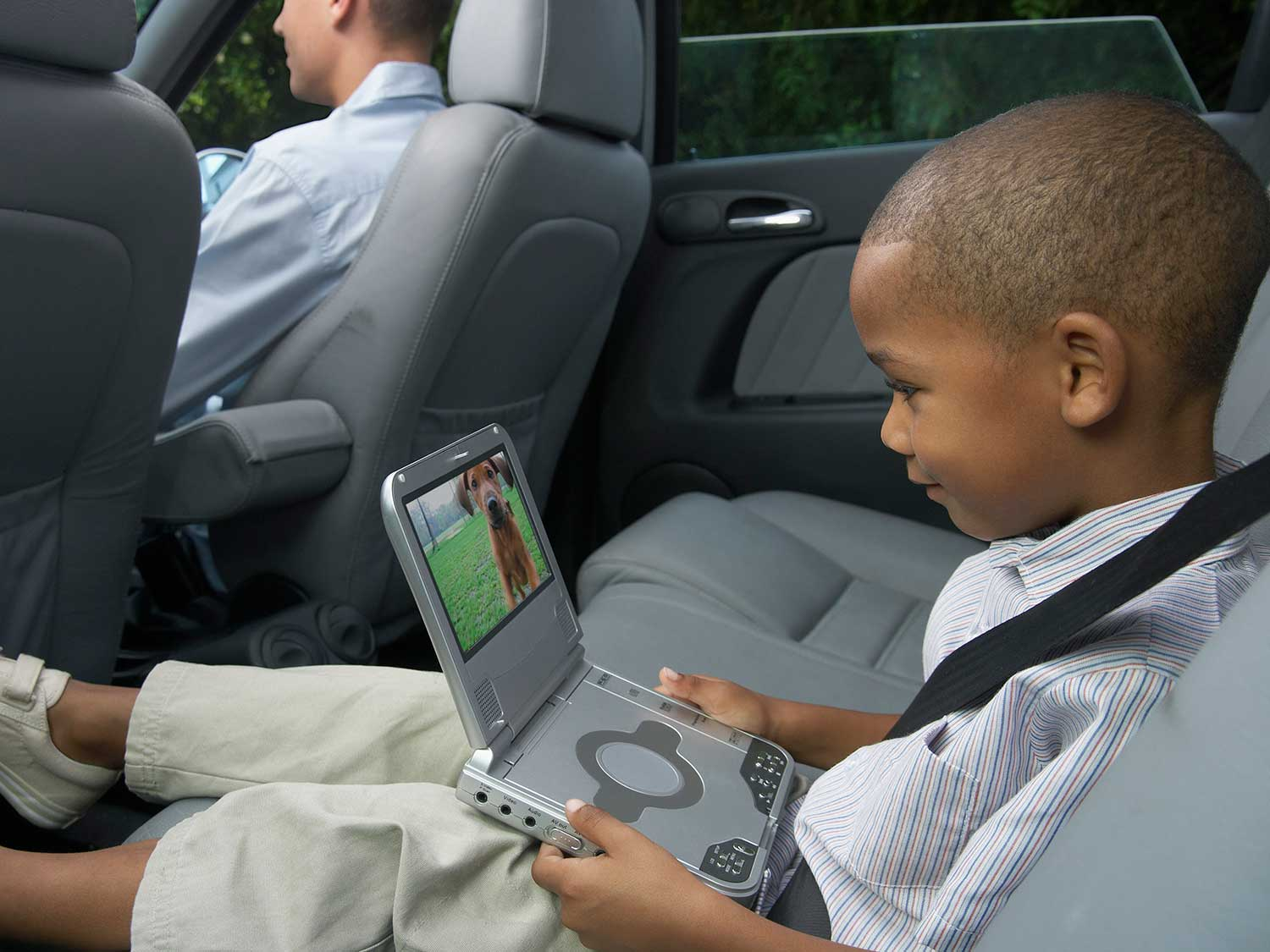 Boy watching movie on portable DVD player.