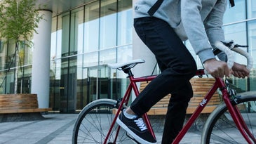 Person riding a red bicycle