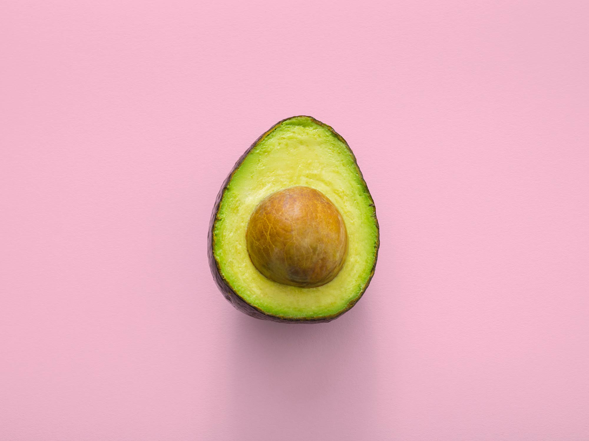 Avocado interior on a pink background