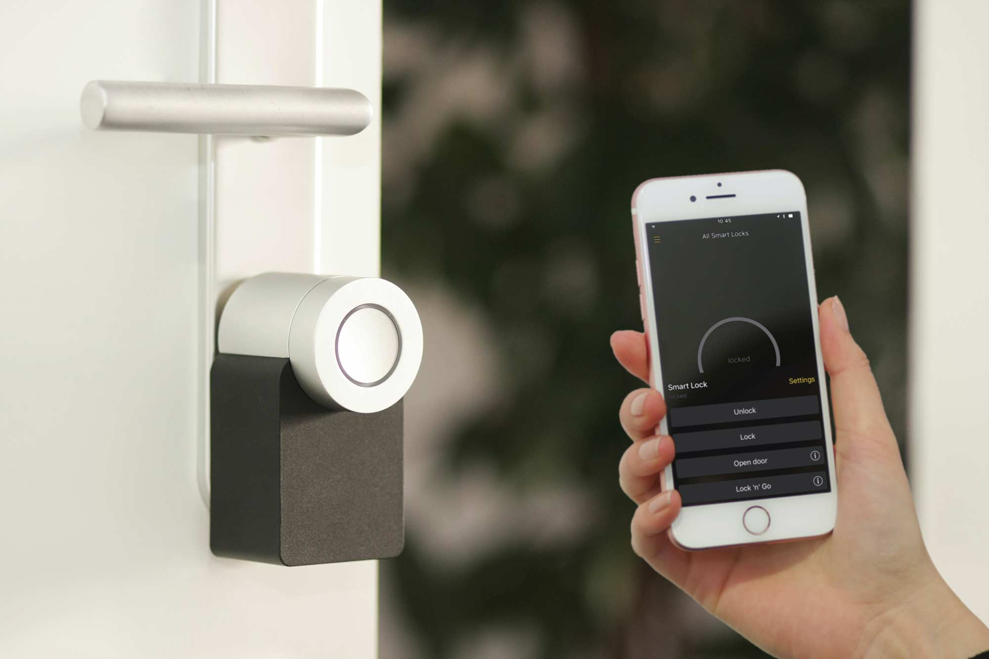 Person holding a smart lock for the home