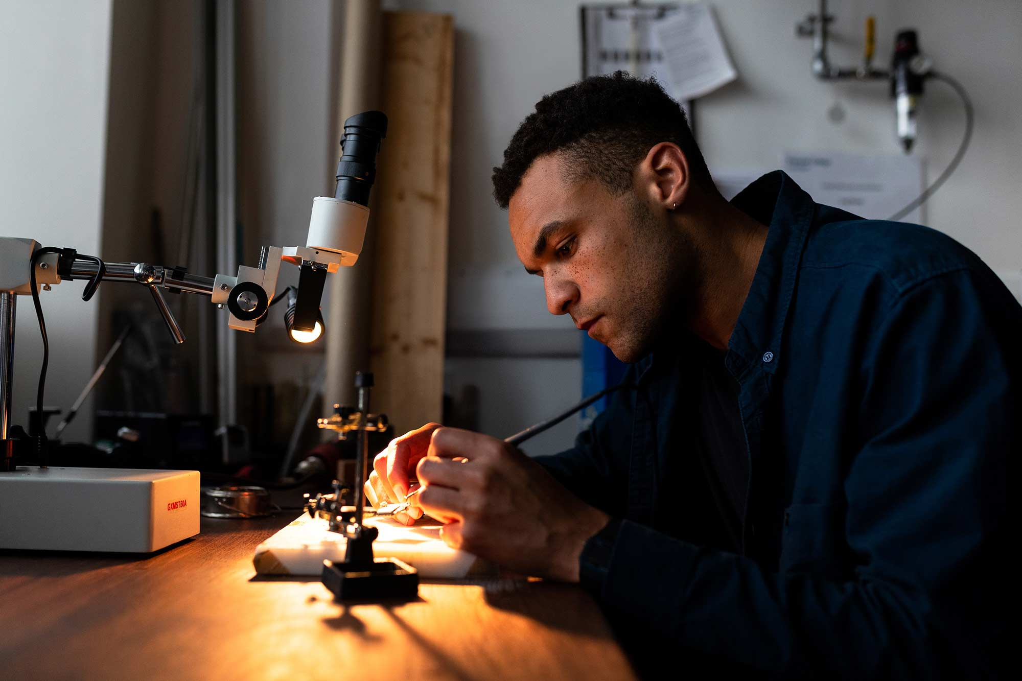 Man working with soldering kit