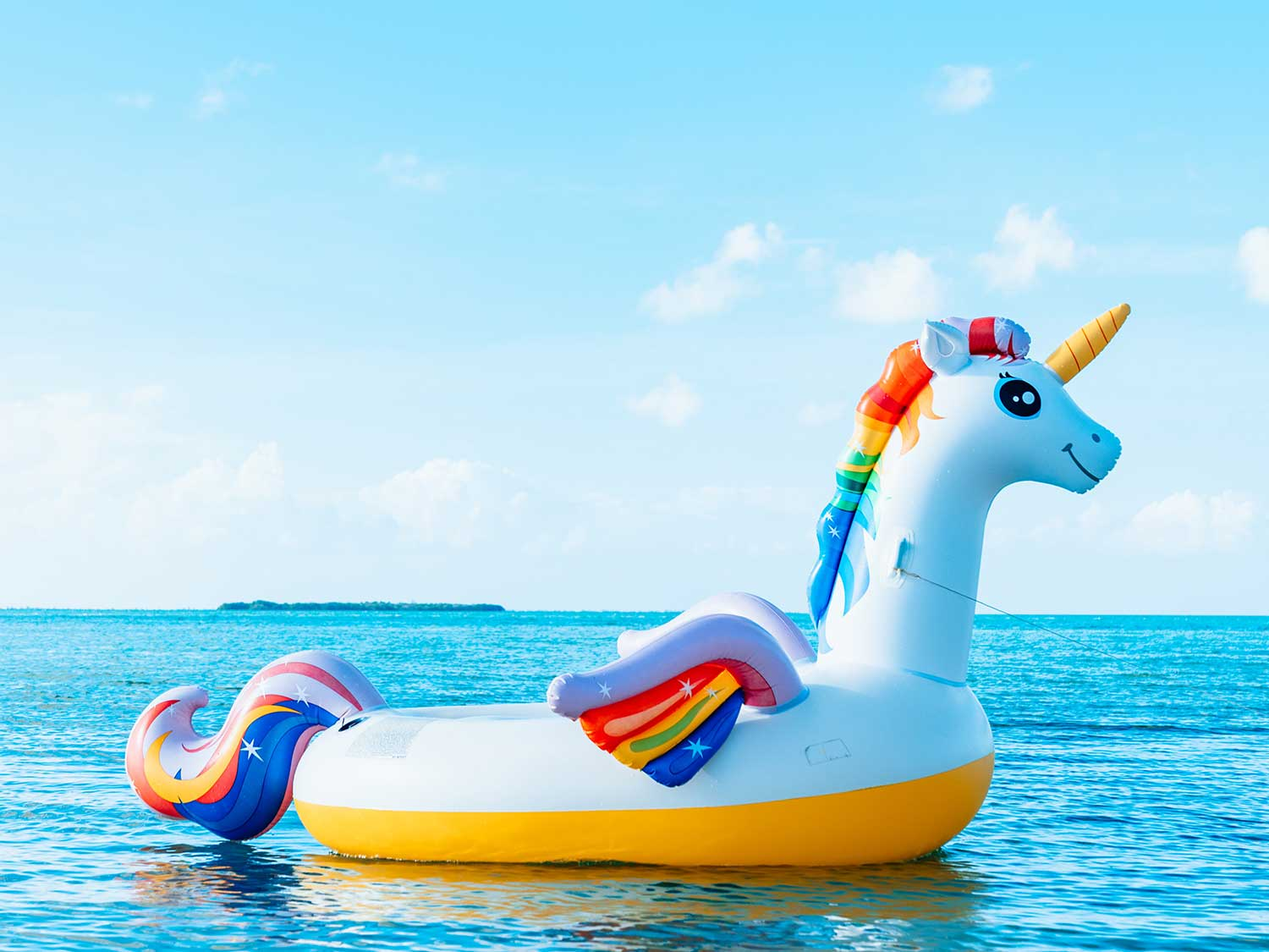Unicorn floating floating in ocean.