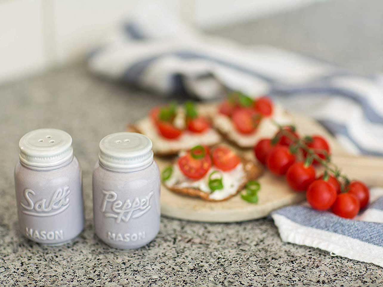 Salt and pepper shakers on kitchen counter.