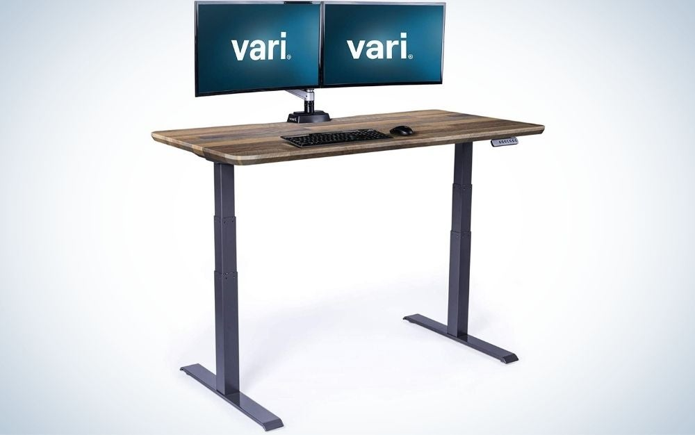 """The Vari Electric Standing Desk 60"""" x 30"""" Dual Motor Sit to Stand Desk is the best overall."""