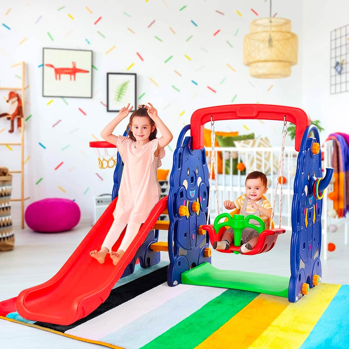 Two young toddlers playing on a toy slide